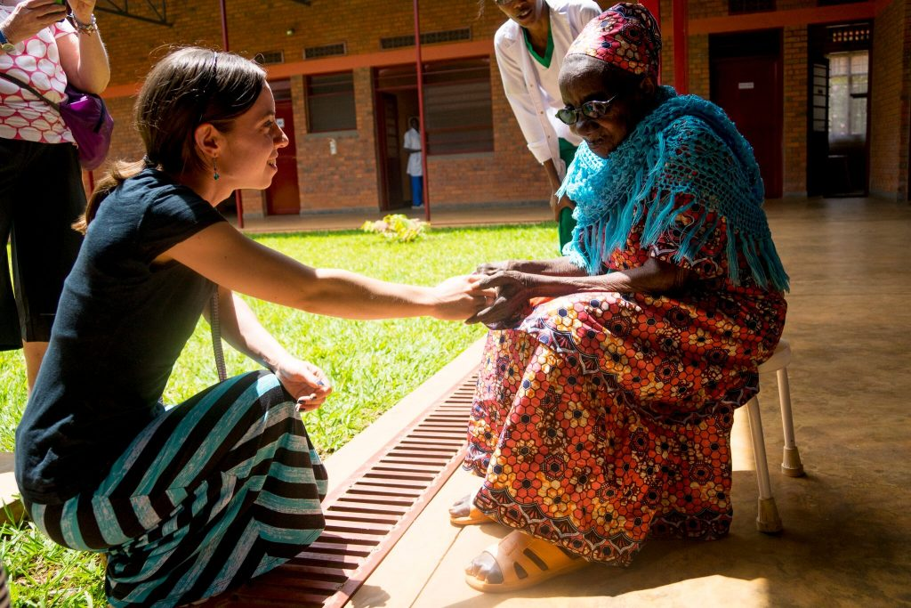 Lianna Mueller ministering to an elder at the Palative Care Hospital Kigali, Rwanda 2016