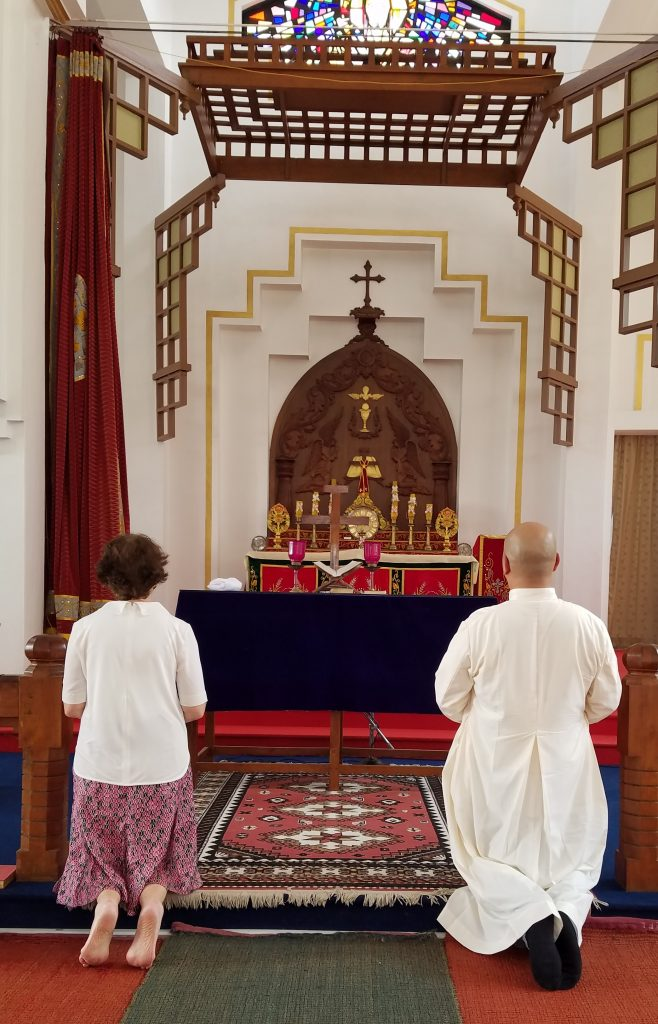 Anne and Fr. Chas Canoy praying in the chapel of the seminary CROPPED