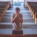 man praying empty pews