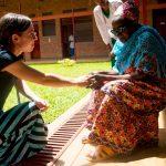 Lianna Mueller ministering to an elder at the Palative Care Hospital Kigali, Rwanda 2016